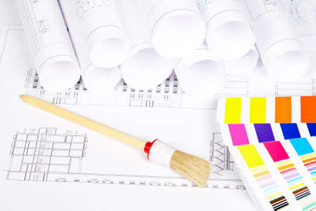 refurbishing: A paintbrush and color guide over the house plan