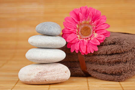 Stack of balanced stones and flower with shallow depth of field photo