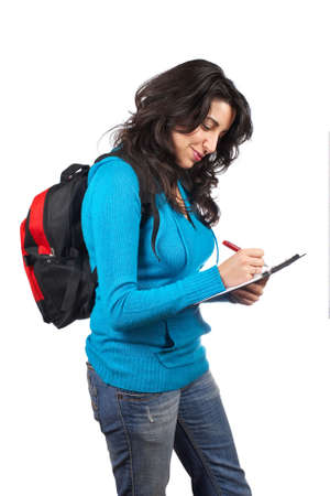 Young student woman with a black backpack  writing on white background photo