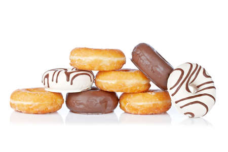 Delicious donuts reflected on white background with shallow depth of field photo