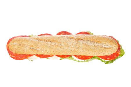 A baguette sandwich with spanish chorizo, lettuce, tomatoes and cheese. Shallow depth of field photo