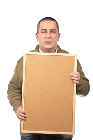 A serious casual man holding the empty corkboard on white background photo