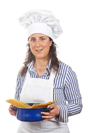 Attractive cook woman holding a blue pan with spaghetti uncooked photo