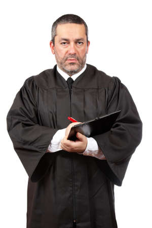 A serious male judge writing on white background photo