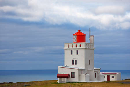 promontory: Dyrh�laey lighthouse, iceland. Built in 1927, standing on a high promontory near the southernmost point of Iceland