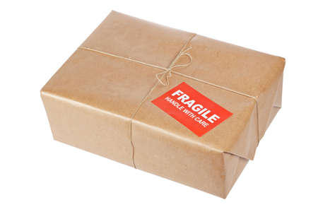 pack string: A fragile parcel wrapped in brown paper and tied with rough twine