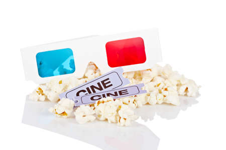 3-D anaglyph glasses, popcorn and two tickets reflected on white background. Shallow depth of field Stock Photo - 7109544