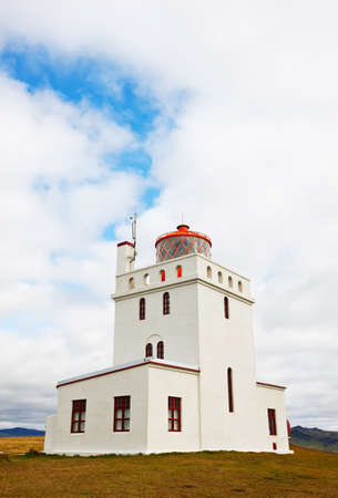 promontory: Dyrholaey lighthouse, iceland. Built in 1927, standing on a high promontory near the southernmost point of Iceland