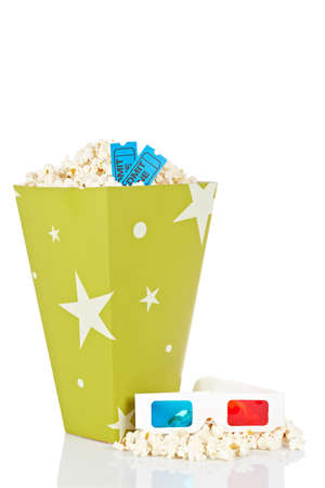 Popcorn bucket with two tickets and 3D anaglyph glasses isolated on a white background Stock Photo - 7345824
