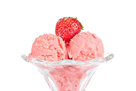 field glass: Delicious strawberry ice cream in glass bowl isolated on white background. Shallow depth of field Stock Photo