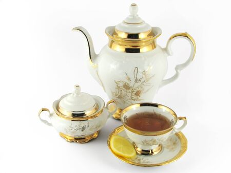 cup on plate with tea and lemon