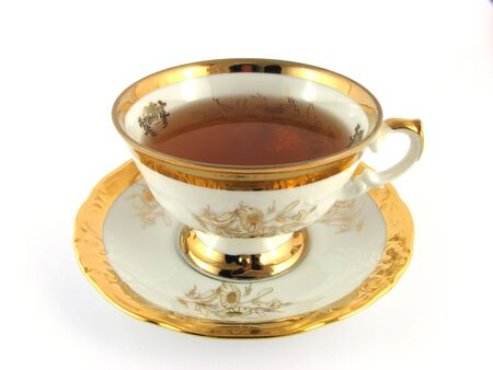 cup on plate with tea , on white background Stock Photo