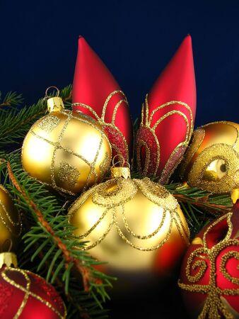 Red and yellow bulbs on Christmas tree Stock Photo