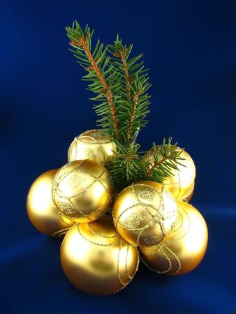 yellow bulbs and Christmas tree on blue background