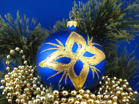 one blue bulb, christmas tree on background