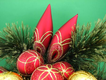 red and gold bulbs on green background