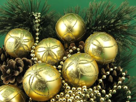 gold bulbs and four cones on christmas tree Stock Photo