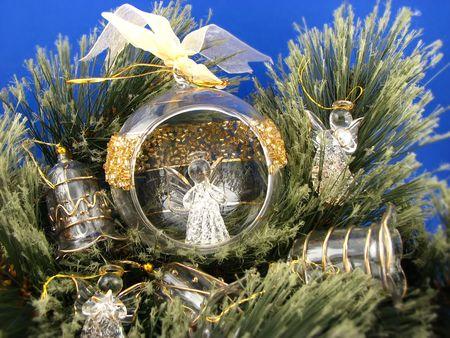 three angels and bulbs  on Christmas tree photo