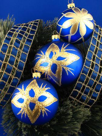 three blue bulbs ahd ribbon on Christmas tree Stock Photo - 2046301