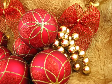 Red bulbs with ribbon on gold background Stock Photo