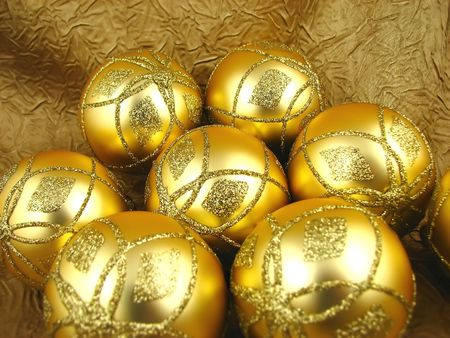 Few beautiful gold bulbs on yellow background Stock Photo - 2053947