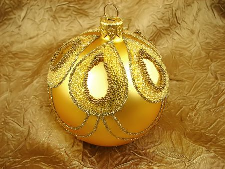 One Christmas bulb on the gold backgraund Stock Photo - 2053945