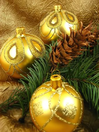 Gold bulbs with cones on Christmas tree Stock Photo - 2053946