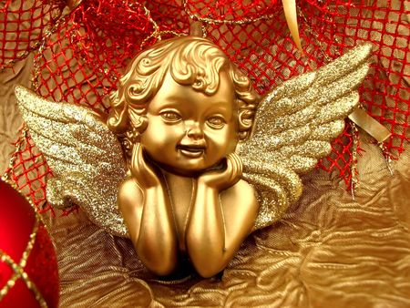 Gold Angel with red ribbon on background