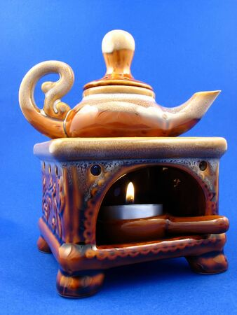 small stove with the teapot on blue background Stock Photo