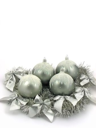 Silver bulbs with ribbon on white background Stock Photo
