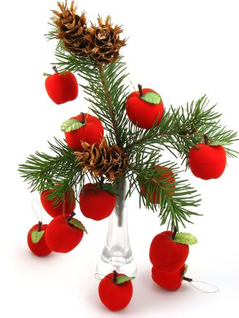 Red Apples and cones on Christmas tree Stock Photo