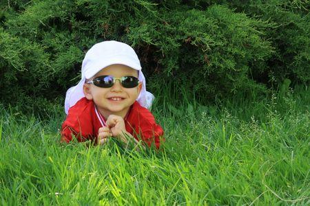 Little beauty boy on the green grass