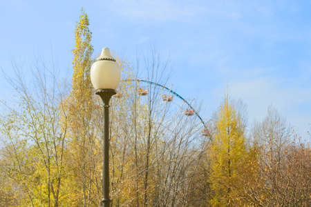 street lamp on the background of trees