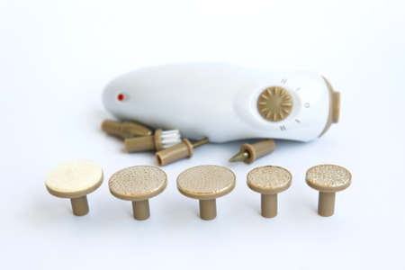 Electric manicure machine and a set of accessories for nail treatment. Imagens