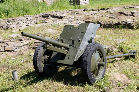 Anti-personnel artillery gun of the second world war is in the field. Weapons of 1941-1945. Stock Photo - 129145570