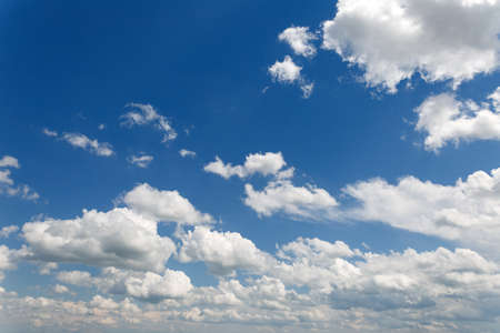 many white clouds against the blue sky