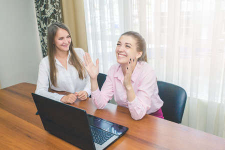 Happy business girl laughing at the Desk. Laughing girls in the workplace.
