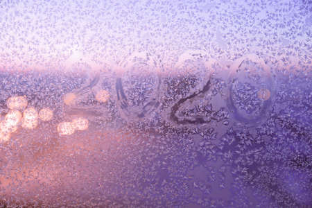 Winter texture of new year 2020. Color texture on glass from cold air Stock fotó