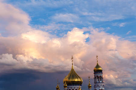 Russian Orthodox Cathedral of the Nativity in Novokuznetsk against a beautiful sky with beautiful clouds.