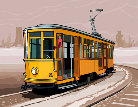 rides: yellow tram rides on rails by a winter city