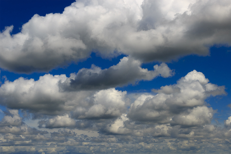 Cumulus clouds and therefore occupy with big weight the most part of a picture, but there are gleams with the blue sky. Clouds are generally white not rain. Stock Photo