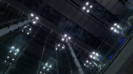 A low-light shot of the light-covered ceiling of the Suvarnabhumi Airport in Bangko, Thailand.