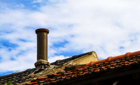 Chimney on rooftop Stock Photo
