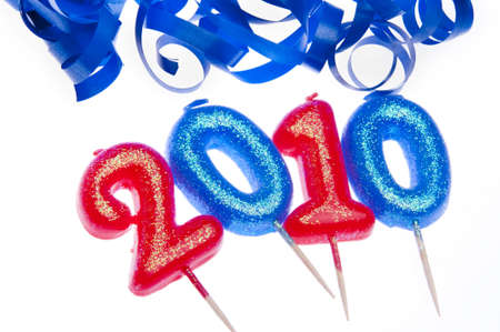 Celebrate 2010 with red and blue candles isolated on a white background with bright blue streamers.