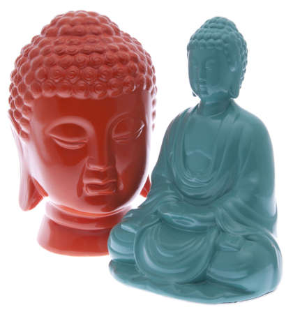 eastern philosophy: Pair of vibrant buddha statues in blue and orange.  File includes clipping path. Stock Photo
