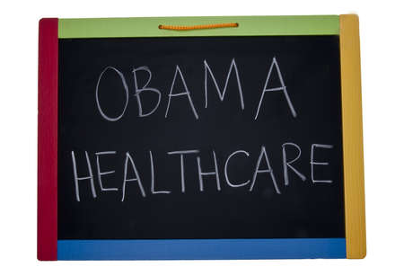 current events: Lesson on Obama Healthcare on a chalkboard. Editorial