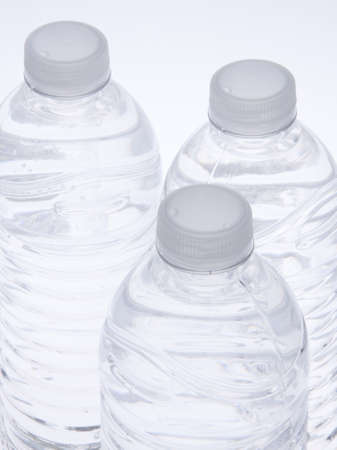 Closeup of a group of water bottles.