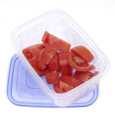 leftover: Leftover Cut tomatos  in a plastic container with condensation from refirgeration. Stock Photo
