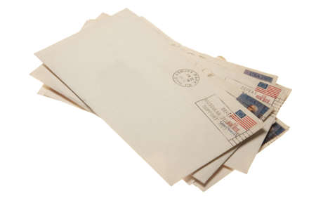 A stack of letters postmarked June 22, 1976 Ashbury Park, NJ. Isolated on a white background withe a clipping path. Stock Photo