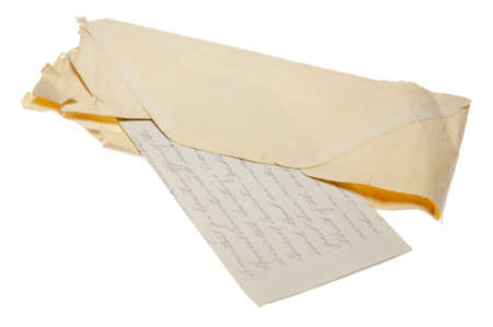 An old letter in a worn envelope with script handwriting isolated on a white background